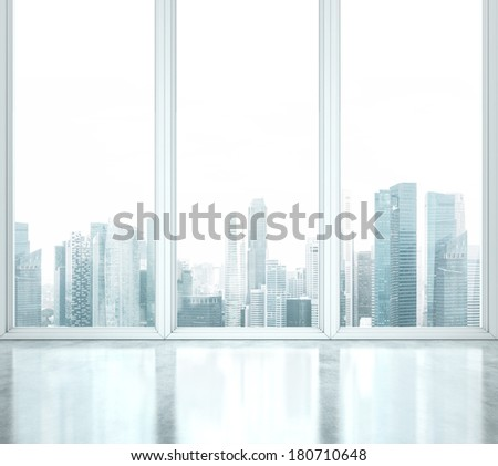 Bright office space with large windows - stock photo
