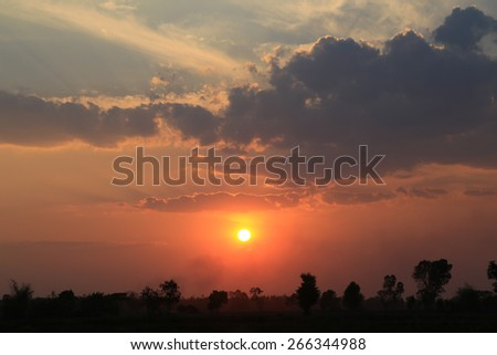 Bright orange and yellow colors sunset sky  - stock photo