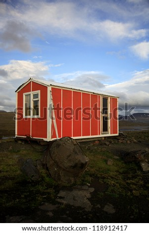 Bright orange emergency hut Iceland
