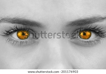 Bright orange eyes on female face looking at camera