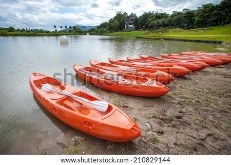 Bright orange kayak at the Lake - stock photo