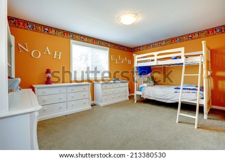 Bright orange kids room with white dressers and bulk bed - stock photo