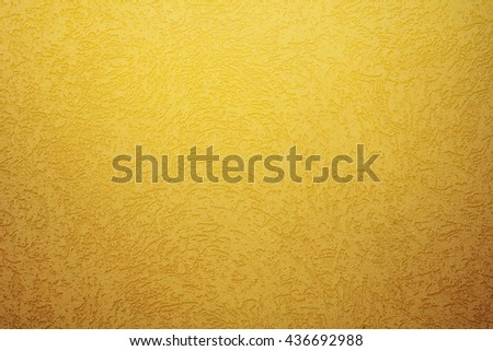 Bright orange textured beige background wall