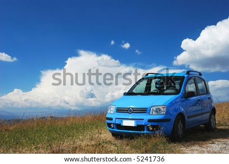 Bright pale blue modern car with beautiful nature background - stock photo