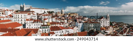 Bright panoramic Lisbon skyline from Miradouro das Portas do Sol in Alfama district, Portugal.