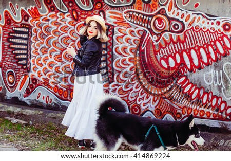bright photo session creative girl and her dog - stock photo