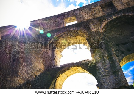 bright picture Colosseum with glimpses and patches of sunlight. Place the public domain. - stock photo