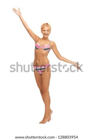 bright picture of beautiful barefoot woman in bikini - stock photo