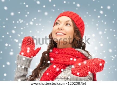 bright picture of beautiful woman in hat, muffler and mittens