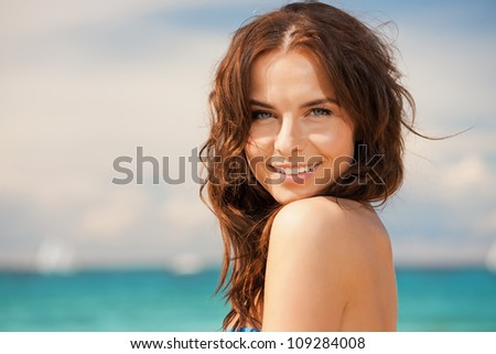 bright picture of beautiful woman on a beach - stock photo