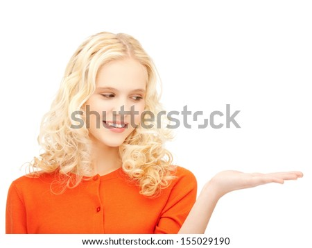 bright picture of beautiful woman with empty hand - stock photo