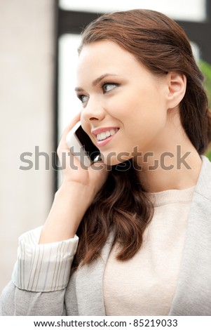 bright picture of businesswoman with cell phone - stock photo