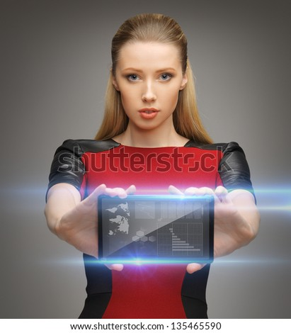 bright picture of futuristic woman with tablet pc - stock photo