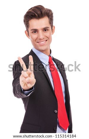 bright picture of handsome business  man showing victory sign - stock photo