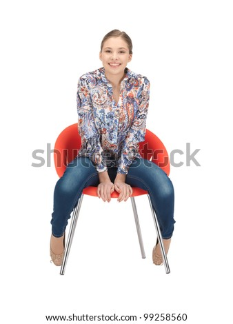 bright picture of happy and carefree teenage girl in chair - stock photo