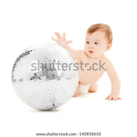 bright picture of happy child playing with disco ball - stock photo