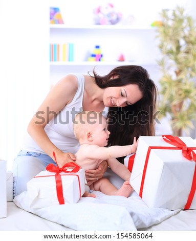 bright picture of happy child with gift box - stock photo