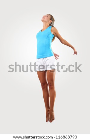 bright picture of happy jumping sporty girl - stock photo