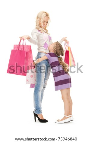 bright picture of happy mother and little girl with shopping bags - stock photo