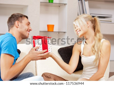 bright picture of happy romantic couple with gift