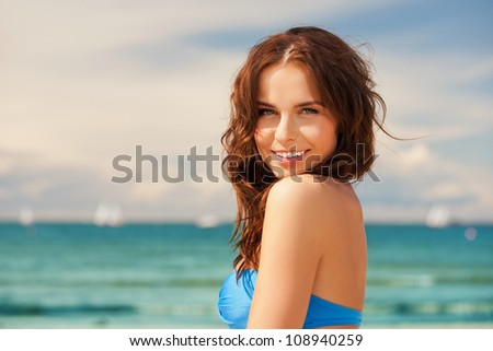 bright picture of happy smiling woman on the beach.