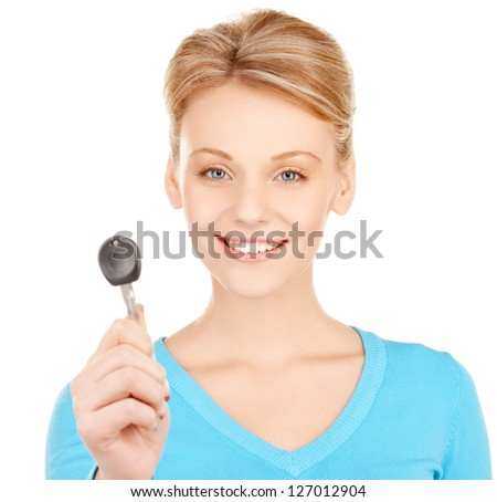 bright picture of happy woman with car key - stock photo