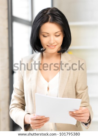 bright picture of happy woman with documents - stock photo