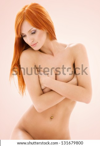 bright picture of healthy naked redhead over beige - stock photo