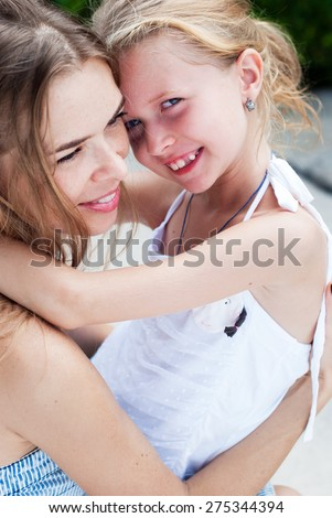 Bright Picture of Hugging Happy Mother and Daughter Teenager - stock photo