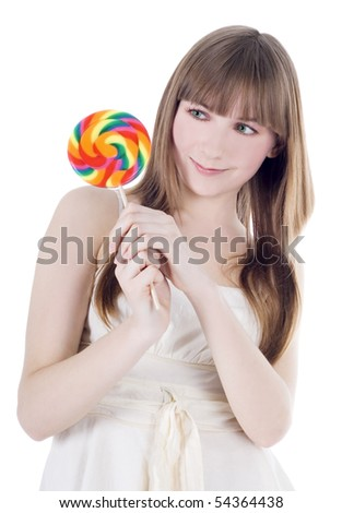 Bright picture of hungry blonde with color lollipop - stock photo