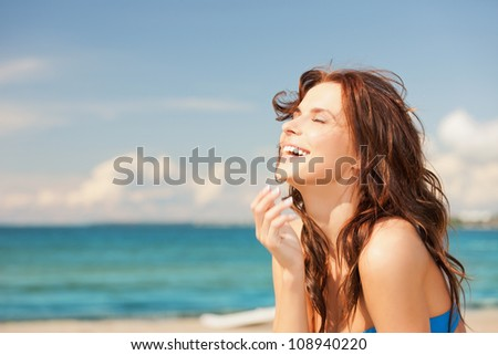 bright picture of laughing woman on the beach. - stock photo
