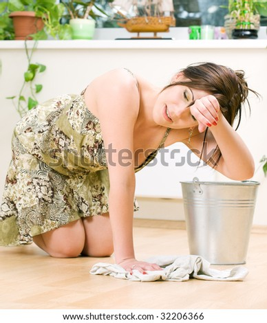 bright picture of lovely housewife cleaning floor - stock photo