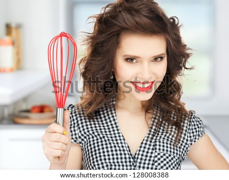 bright picture of lovely housewife with cooking eqipment. - stock photo