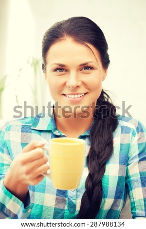 bright picture of lovely housewife with mug - stock photo