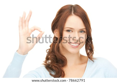 bright picture of lovely teenage girl showing ok sign - stock photo