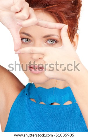 bright picture of lovely woman creating a frame with fingers