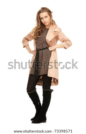 bright picture of lovely woman in coat - stock photo