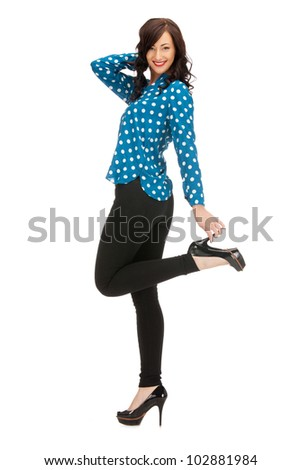 bright picture of lovely woman  in shirt and trousers - stock photo