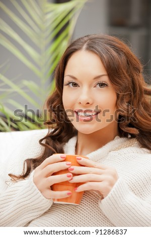 bright picture of lovely woman with mug