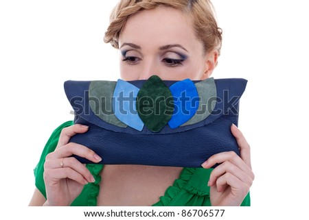 bright picture of lovely woman with small handbag - stock photo
