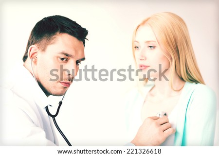 bright picture of male doctor with patient - stock photo