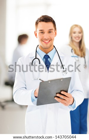 bright picture of male doctor writing prescription - stock photo