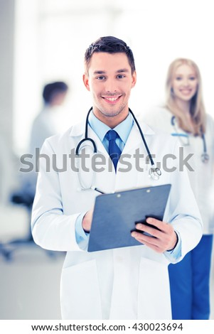 bright picture of male doctor writing prescription