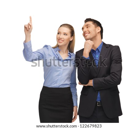 bright picture of man and woman pointing their fingers.