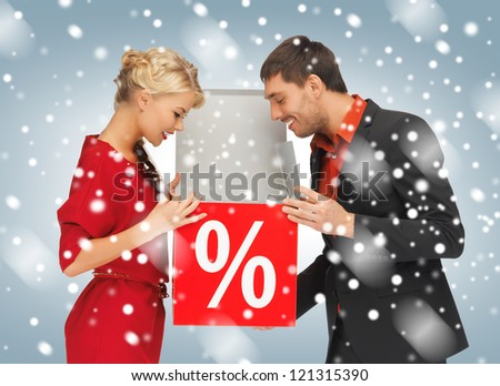 bright picture of man and woman with percent sign - stock photo