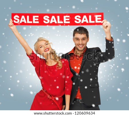 bright picture of man and woman with sale sign - stock photo