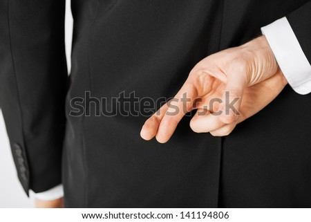bright picture of man with crossed fingers