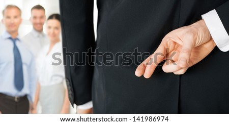 bright picture of man with crossed fingers - stock photo