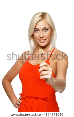 Bright picture of pretty young lady giving you keys, focus at the girl, isolated on white background