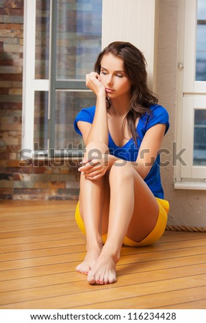 bright picture of sad and lonely woman - stock photo